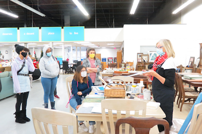 Habitat for Humanity upcycle volunteer speaks to students at ReStore in Poughkeepsie